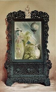 內頁3. a Chinese looking-glass in carved wood frame 中國黑檀木雕花鏡。