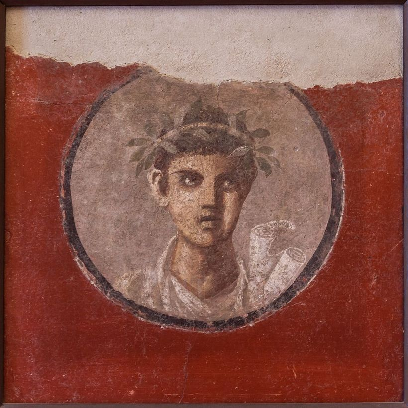 MANNapoli_120620_a_Fresco_young_man_with_rolls_from_Pompeii_Italy